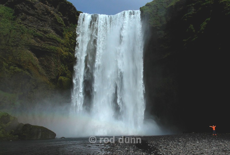 Skogafoss and woman - Iceland